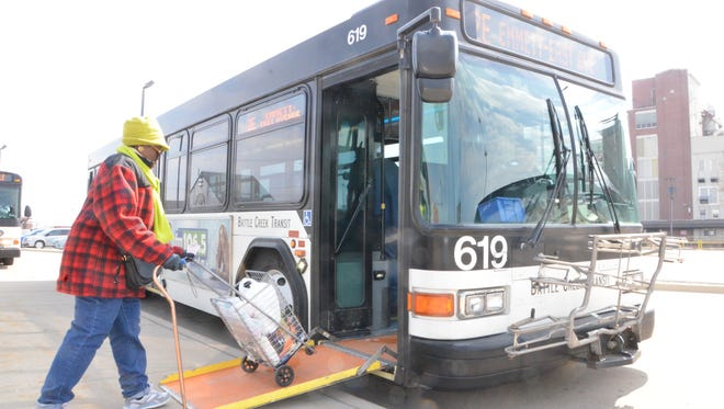 Yolanda Watkins boards a bus at the Battle Creek Transit bus transfer station.