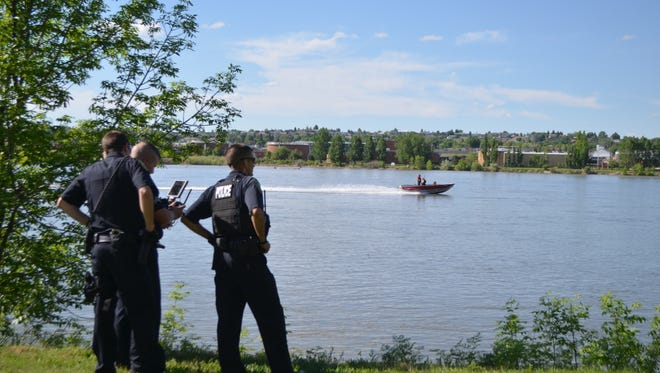 A search and rescue boat angles toward GFPD's drone used to find a man's body floating in the Missouri River on Friday afternoon.