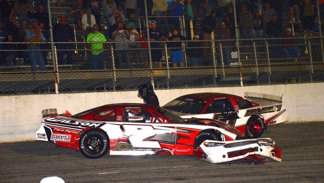 After a collision that took out both cars, Stephen Nasse stands outside Donnie Wilson's No. 2 car and delivers punches through Wilson's window net at Five Flags Speedway on April 27.