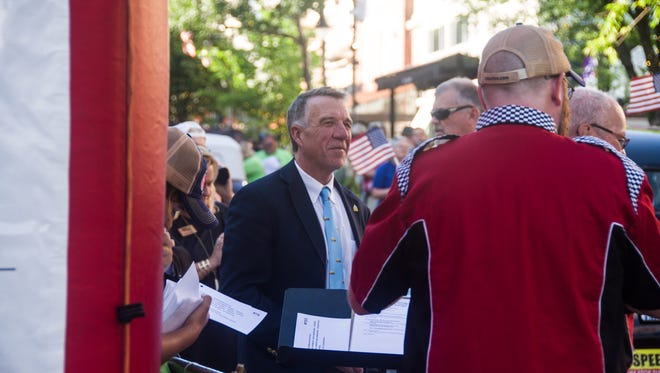 Gov. Phil Scott attends the Great Race, an antique and vintage car event, on Church Street Marketplace in Burlington on Monday evening, June 25, 2018.