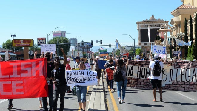 After holding South Virginia Street closed for an hour, protesters marched two blocks north down the center of the street to a nearby church.