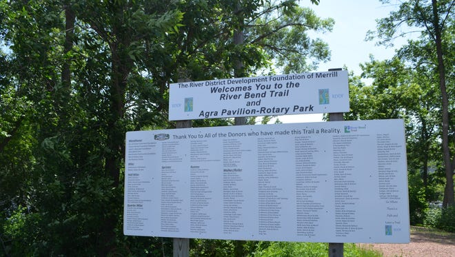 A sign at the River Bend Trail welcoming visiting and listing donors for the Agra Pavilion and Rotatry Park trail-head.