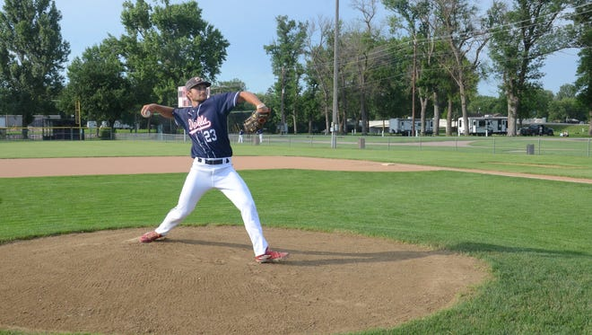 Dell Rapids' Legion baseball pitcher 19-year-old Josh Roemen warms up before a game. Roemen was a member of the Dell Rapids High School title team in 2017 and pitched as a freshman at Mount Marty College in Yankton this spring.