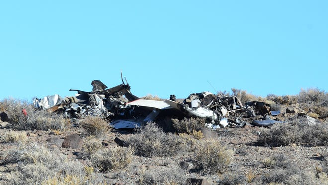 Airplane wreckage from a two-airplane mid-air collision Sunday morning around 8 a.m. in the hills northwest of Yerington, after they had taken off from a nearby dry lakebed.