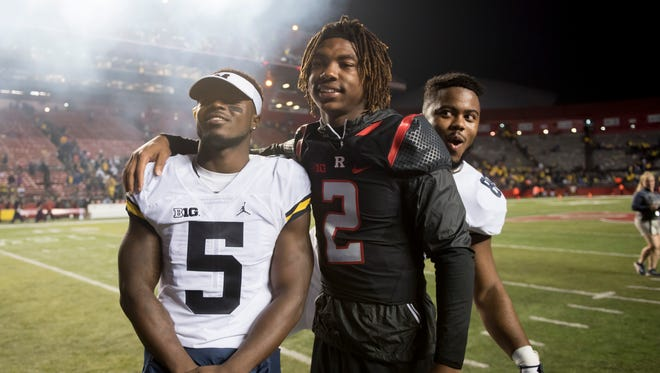 Michigan fullback Khalid Hill, right, photobombs teammate Jabrill Peppers, left, and Rutgers' Ahmir Mitchell as the two take a photo together after the game. Mitchell is a former Michigan receiver who transferred to Rutgers.