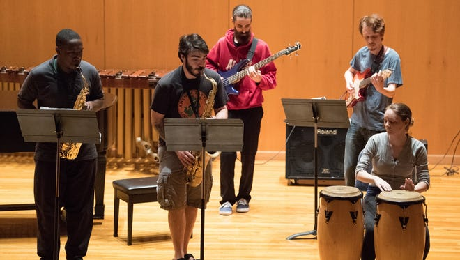 From left, students Jonathan Swain, Neil Tiller, Ryan Etheridge, J. Rowe and Vivienne Boudreaux practice performing a jazz combo March 22, 2017, during the chamber music coaching class at the University of West Florida in Pensacola.