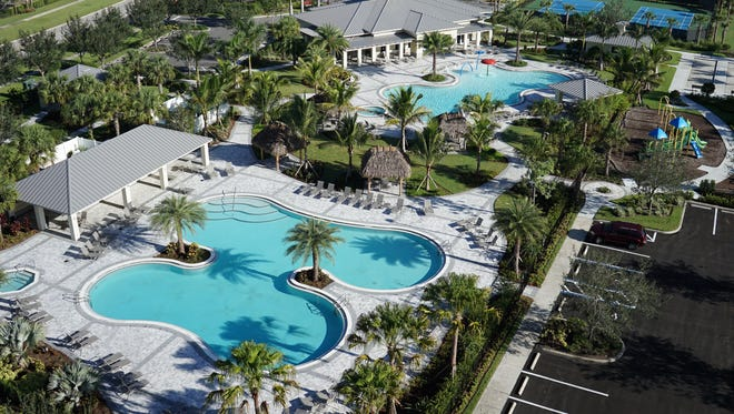 The Ronto Group's Orange Blossom Naples community's resort style amenities include two pools and a spa that serve as the centerpiece of the community's amenity offering.