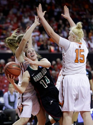 Green Bay guard Megan Lukan, center, tries to shoot between Princeton guard Blake Dietrick, left, and forward Annie Tarakchian in the second half of an NCAA college basketball game in the first round of the NCAA tournament, Saturday, March 21, 2015, in College Park, Md. Princeton won 80-70. (AP Photo/Patrick Semansky)