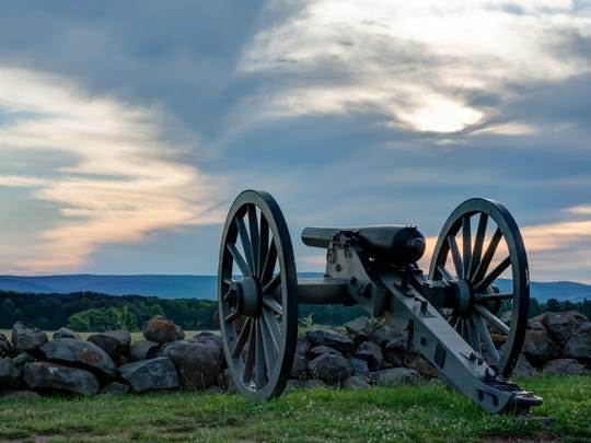 A Civil War replica cannon and carriage overlooks Gettysburg National Military Park in Pennsylvania. Memorial ceremonies in both the North and South began shortly after the war.