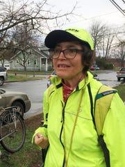 Jane Hendley, a Flynn Avenue resident, walks east toward