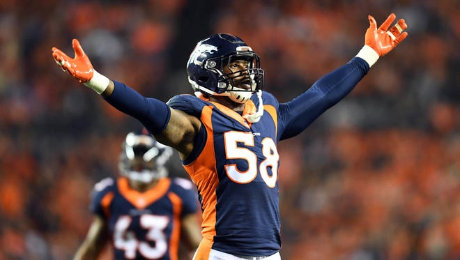 Oct 24, 2016; Denver, CO, USA;  Denver Broncos outside linebacker Von Miller (58) attempts to rally the crowd in the fourth quarter against the Houston Texans at Sports Authority Field at Mile High.