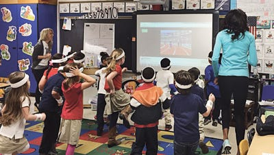 Ridge Elementary School teacher, Cassandra Tate, engages her students in an interactive track and field game from GoNoodle.