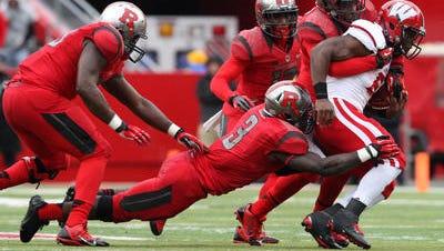 Familiar scene for Rutgers' defense: Steve Longa making a tackle.