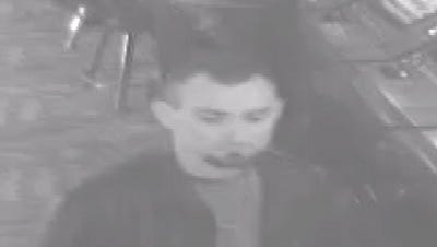 A submitted photo of security footage of a man sought in a shooting at the Gold Dust West casino.