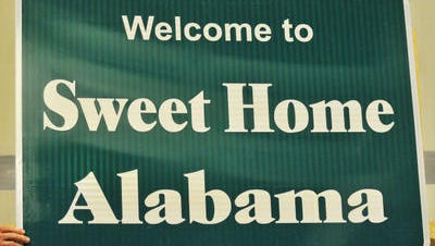 """""""Welcome"""" signs read """"Welcome to Sweet Home Alabama."""""""