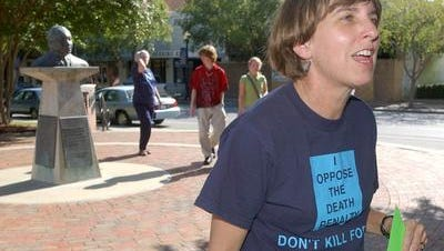 Susan Watson during a death penalty protest in Pensacola in 2003. Watson died Friday after a brief illness.
