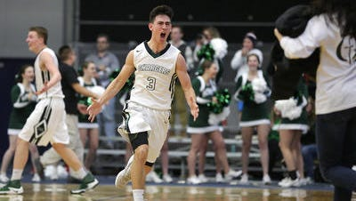 Kettle Moraine Lutheran's Grant Biesterfeld celebrates his team's victory over Waupun in the sectional final Saturday.
