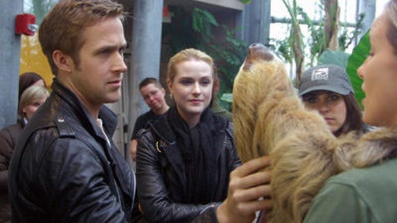 "Ryan Gosling and Rachel Evan Wood meet a sloth at the Cincinnati Zoo during a break from filming ""The Ides of March"" in 2011."