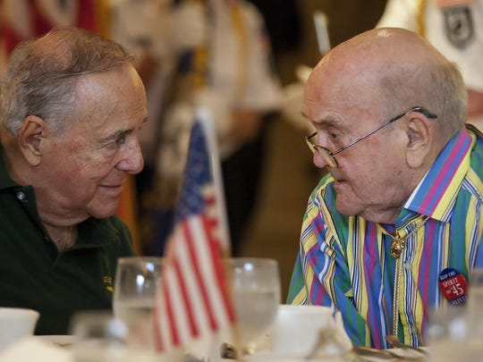 World War II veterans Tony Gentuso, left, and Ray Carlson were among those at the Lee County annual Spirit of '45 ceremony in 2014. Naples and Fort Myers are planning ceremonies this month.
