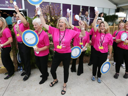 KINFAY MOROTI/THE NEWS-PRESS... Naples Winter Wine Festival volunteers launch the live auction Saturday (1/30/16) at the Ritz-Carlton Golf Resort in Naples.