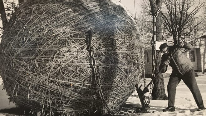 Francis Johnson used a railroad jack to turn his twine ball to ensure it kept its round form.