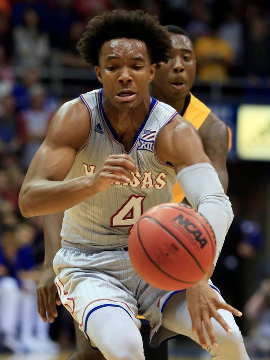 Graham scores 35 as No. 2 Kansas routs Toledo 96-58