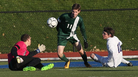From left, Schechter goal keeper Harry Alsfine and Jack Weissman (11) combine to stop Seward's Jason Hardy (18) during first half action in the boys soccer regional semifinal at Middletown High School Oct. 31, 2017.