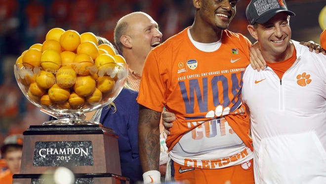 Clemson coach Dabo Swinney poses with quarterback Deshaun Watson (4) during Orange Bowl trophy presentation following the win over Oklahoma on Thursday.