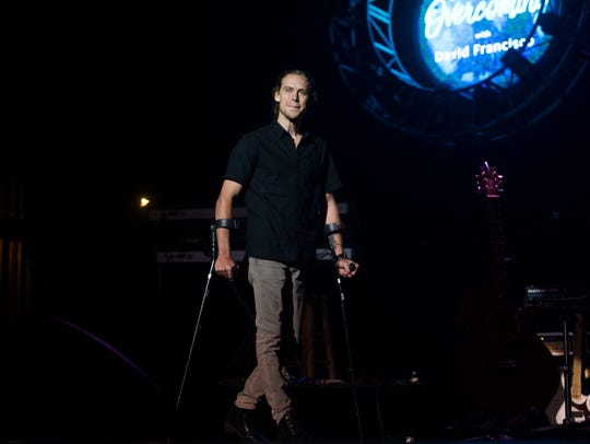 Musician David Francisco walks on stage while opening