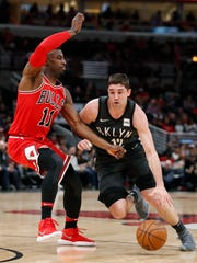 Apr 7, 2018; Chicago, IL, USA; Brooklyn Nets forward Joe Harris (12) drives to the basket against Chicago Bulls forward David Nwaba (11) during the first half at United Center. Mandatory Credit: Kamil Krzaczynski-USA TODAY Sports