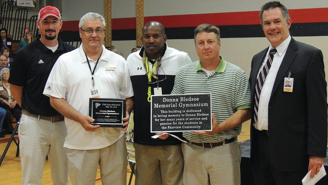 The gymnasium at Fairview Middle School was officially dedicated as the Donna Bledsoe Memorial Gymnasium during a special ceremony on the last day of school. Pictured (l-r) FMS Athletic Director Preston Brooks, Donna's husband Ricky Bledsoe, Coach Darnell Spann, Coach Chris Hughes and FMS Principal Gary Shrader.