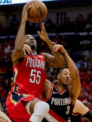 Portland guard CJ McCollum (3) draws a flagrant foul against New Orleans forward E'Twaun Moore (55) during the second quarter in game four of the first round of the 2018 NBA Playoffs at the Smoothie King Center.