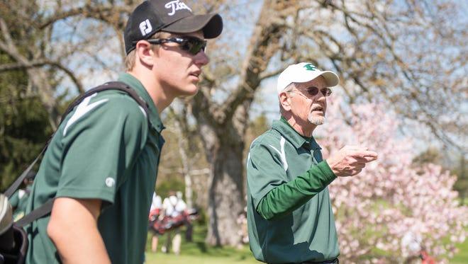 Pennfield interim golf coach Fred Beronja with senior Tyler Driscoll.