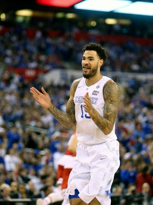 Kentucky's Willie Cauley-Stein reacts after making a dunk against Wisconsin. April 4, 2015