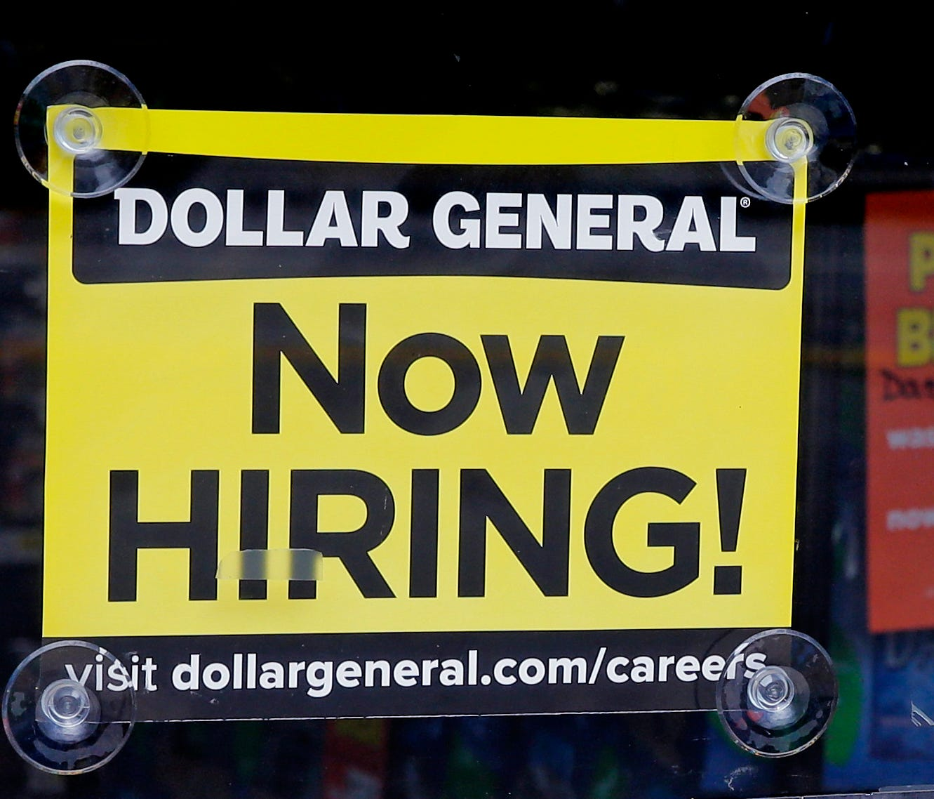 File photo taken in 2016 shows a hiring sign at a Dollar General store in Methuen, Mass.