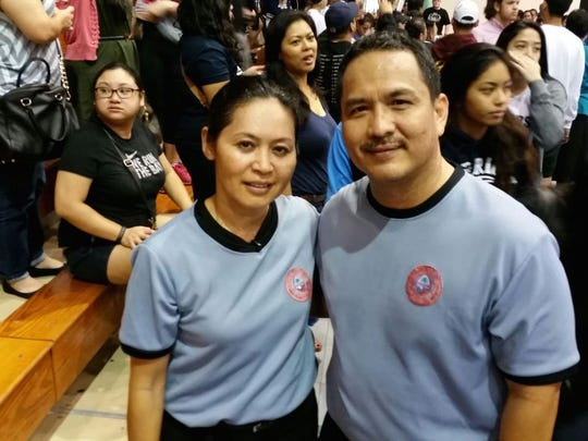 Marianas Sports Officials Association referees Susan Lupola (left) and Joe Carbullido (right) at the Independent Interscholastic Athletic Association of Guam's high school girls basketball game on Dec. 18 at Southern High School gym.