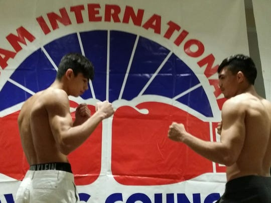 Ethan Reyes, left, is an up-and-coming kickboxer who trains at UMA. He defeated Robert Wusstig during a recent fight.