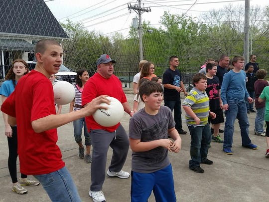 The students ready themselves for a game of dodgeball.