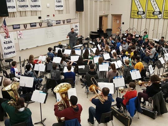 Director of Bands G. Jonathan Thomann in practice with