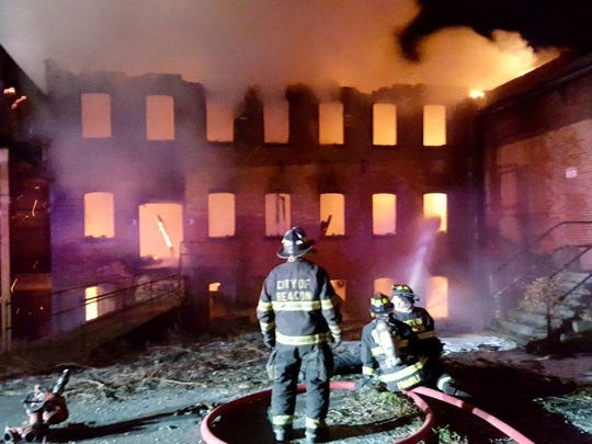 Firefighters battle a blaze at an abandoned factory at Madam Brett Park in the City of Beacon on Tuesday, Jan. 31, 2017.
