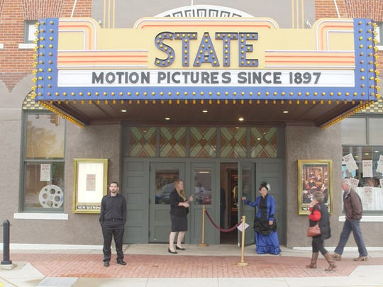 """An image of Washington, Iowa's State Theatre, confirmed by the Guinness Book of World Records to be the oldest continuously operating movie theater in the world, from the movie """"Saving Brinton."""""""