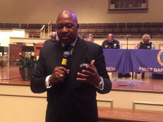 Rev. Keith Norman prays at the start ofThe Commercial Appeal's Crime & Solutions Town Hall forum on solutions to gun crime.
