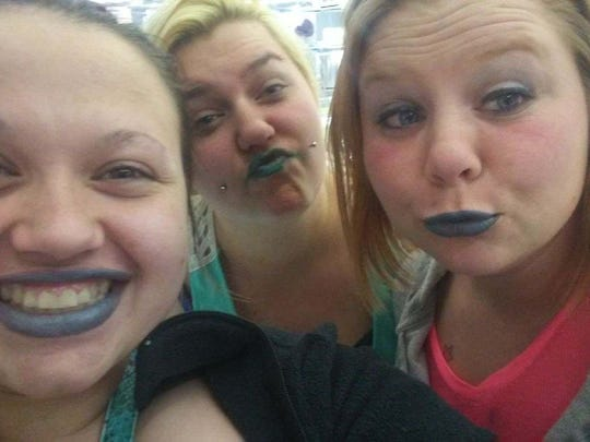 Clarissa Halburn (left) and her sister Jessica Gomez (right) hang out at Wal-Mart with their cousin and try on blue lipstick.