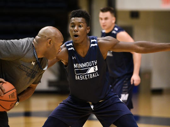 Monmouth University freshman Melik Martin defends assistant coach Jamal Meeks during a recent practice