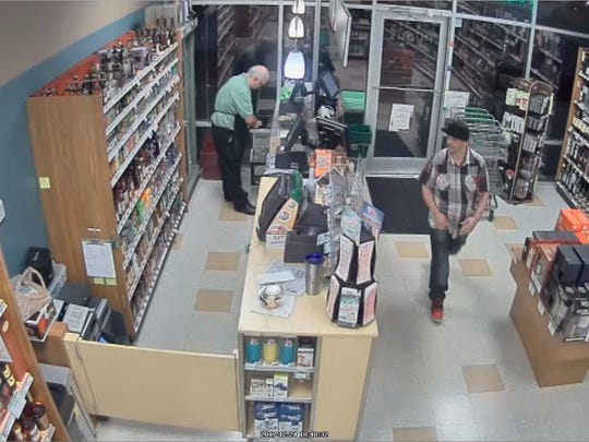Sebastian police are looking for a man, seen at right, suspected of robbing a Publix Liquors store on Christmas Eve.