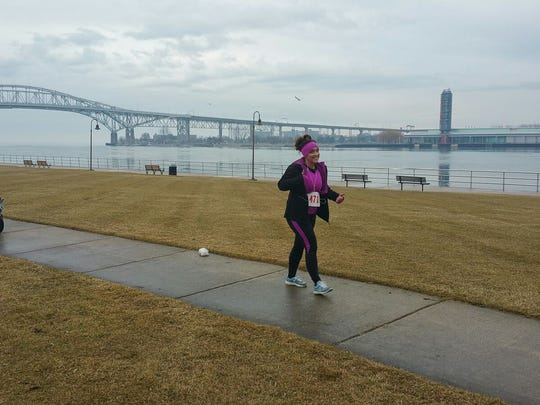 Carol Nemecek runs the PoHo Hot Cocoa Run Jan. 27, two years after surviving a massive heart attack in the same race.