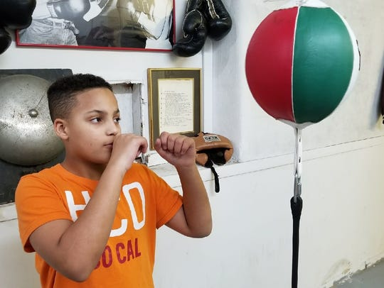 Elijah Karlovetz, 12, of Fremont, will fight for the