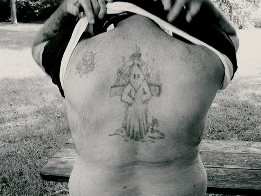 One of tattoo artist Billy Joe White's clients shows a tattoo of a Ku Klux Klansman who has asked to be covered up.