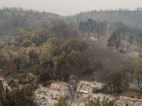 An aerial view of the homes of Harlan Drive and Bedrock Lane in the Lake Redding Estates neighborhood show the devastation caused by the Carr Fire which roared through the area on July 26. The area remained closed to residents for several days as crews worked to restore some of the infrastructure in the area. The fire destroyed 1,079 homes in all of Shasta County.