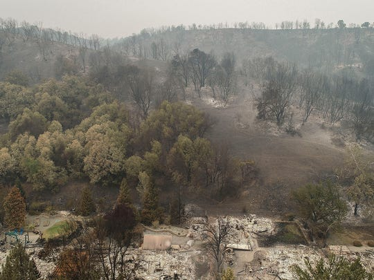 An aerial view of the homes of Harlan Drive and Bedrock Lane in the Lake Redding Estates neighborhood show the devastation caused by the Carr Fire which roared through the area late last week.